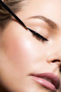 Close-up make-up with black eyeliner